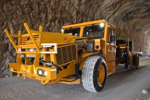 A picture of MEDATech's EV Boom Truck. A battery powered electric mine truck
