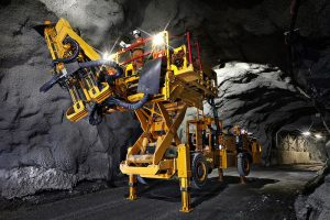 A picture of the battery electric underground roof bolter in a mine
