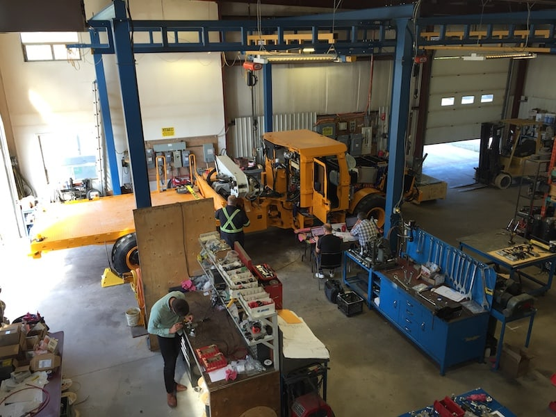 A picture of an EV boom battery-powered electric mine truck during its final assembly