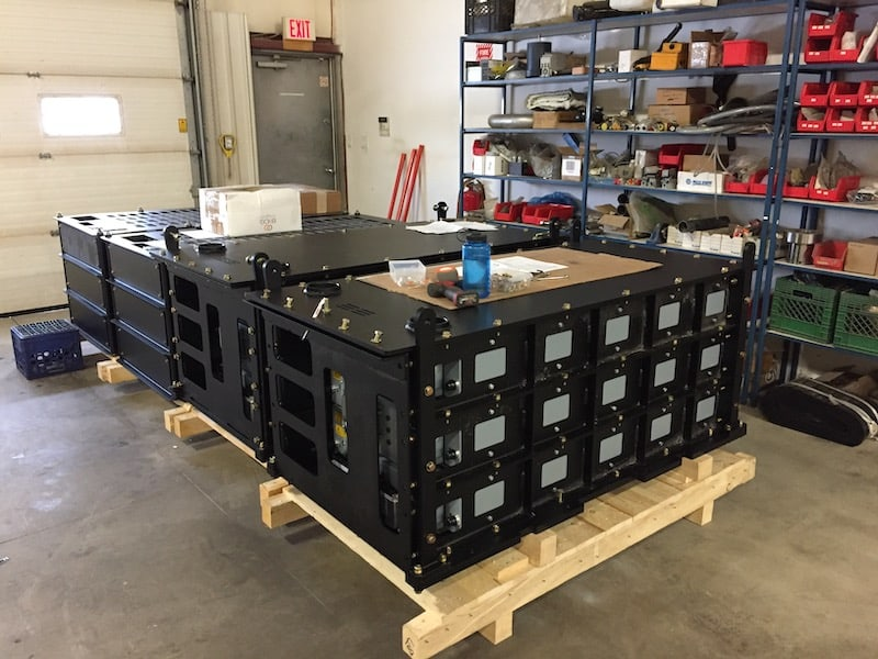 A picture of multiple lithium ion battery packs ready for delivery